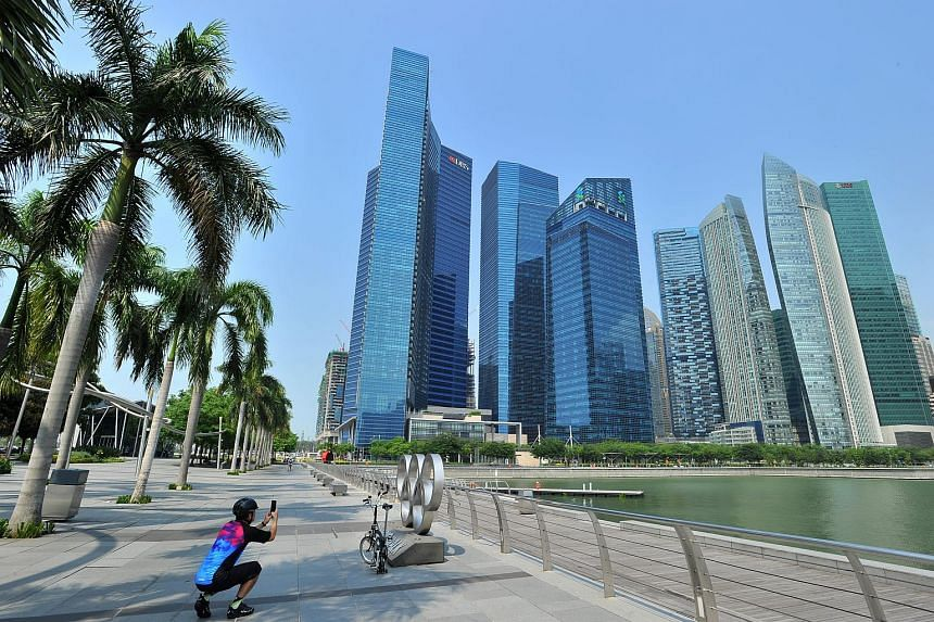 Marina Bay Financial Centre against backdrop of business district skyscrapers, on Sept 2, 2015.