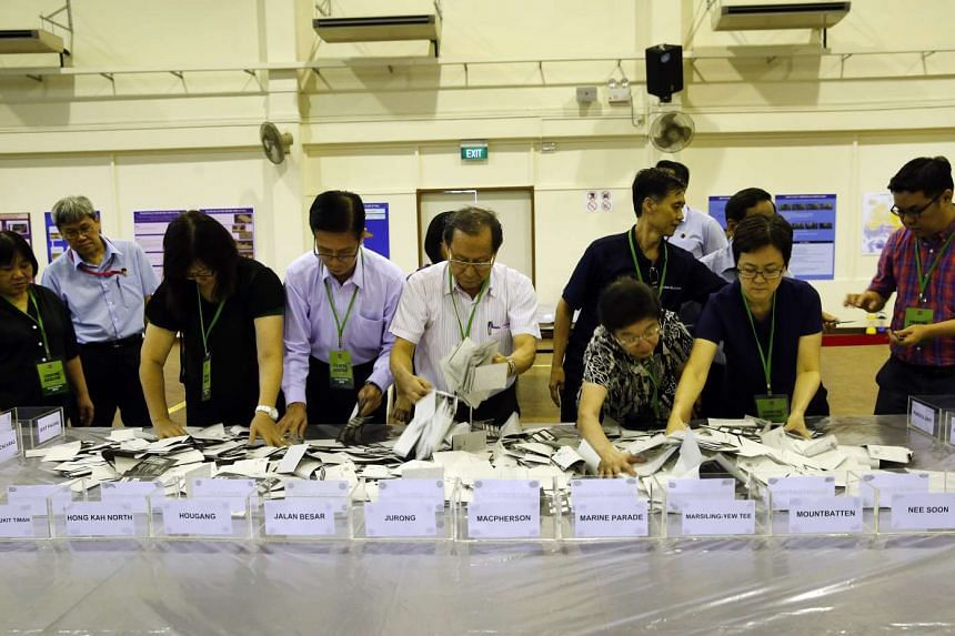 The votes cast at 10 oversea polling stations were counted in Singapore on Tuesday, Sept 15, 2015.
