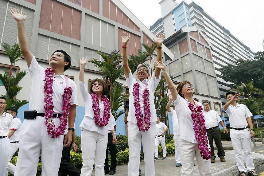 (From left) PAP's Jalan Besar GRC team, Mr Heng Chee How, Dr Lily Neo, Dr Yaacob Ibrahim and Ms Denise Phua wave at supporters during their Jalan Besar thank-you procession.