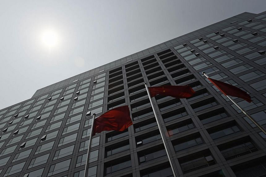 The Chinese flag flies outside the offices of the China Securities Regulatory Commission in Beijing on July 9, 2015.