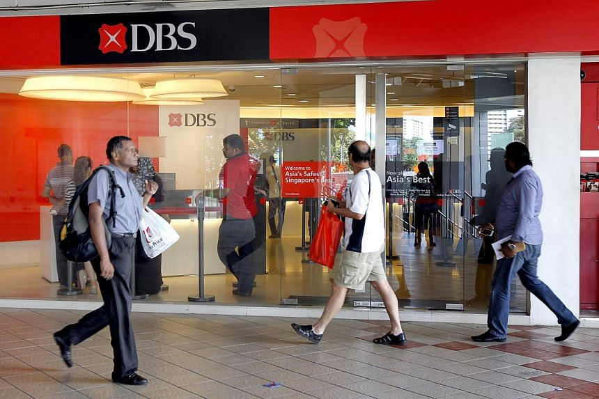 People walk past the DBS branch at Rochor Centre.
