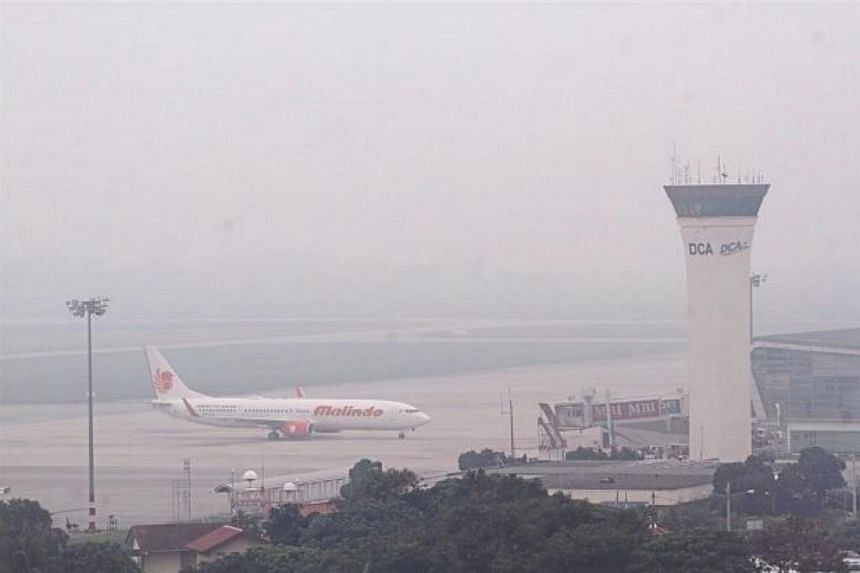 Safety hazard: A thick haze reducing the visibility level at the Penang International Airport in Bayan Lepas.