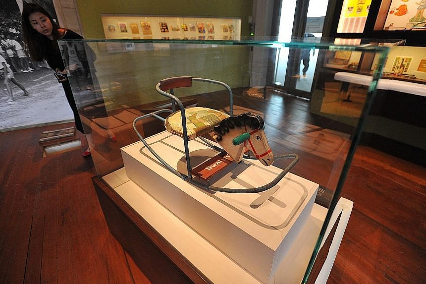Relive the experience of Singapore's only open-air drive-in cinema, which used to be in Jurong - sit in cars (right) to watch a montage of archival clips. Part of the Asian Civilisations Museum collection, this gramophone's distinctive flower-shaped