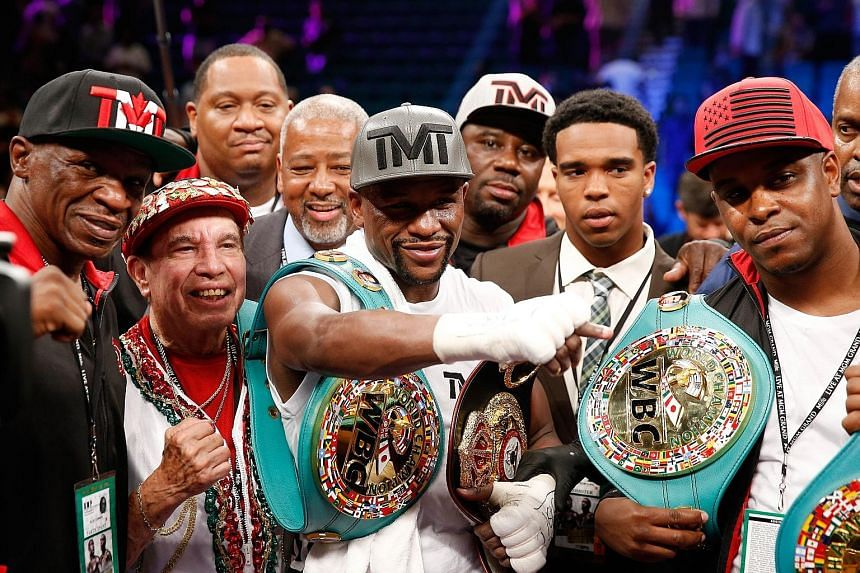 Floyd Mayweather (centre) keeps his unbeaten record intact after beating Andre Berto but many pundits do not see him in the class of true greats like Muhammad Ali, Roberto Duran and Sugar Ray Robinson.
