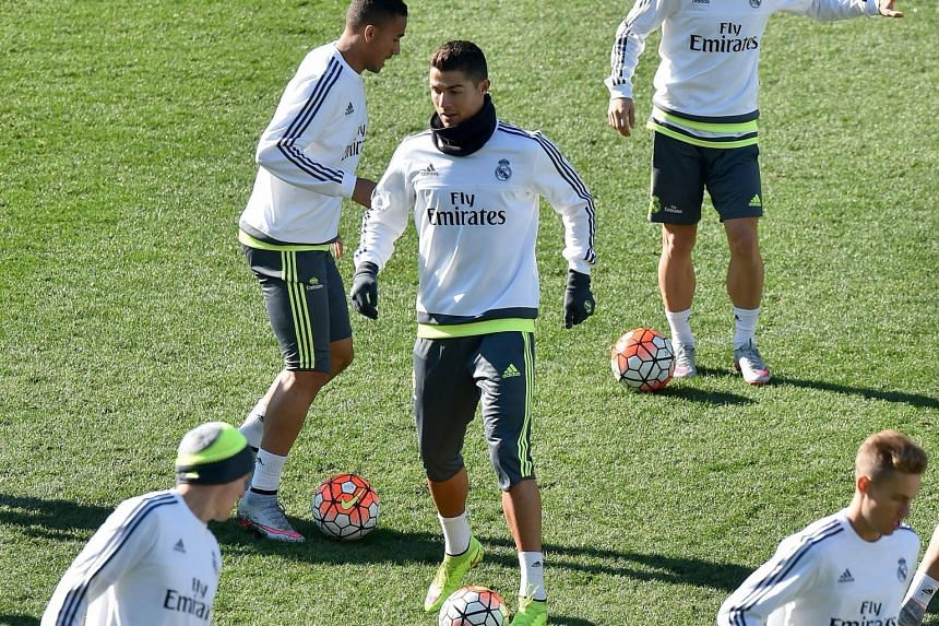 Cristiano Ronaldo (centre), in a team training session, erased all doubts about his form this season when he plundered five goals in a Spanish La Liga game against Espanyol on Saturday.