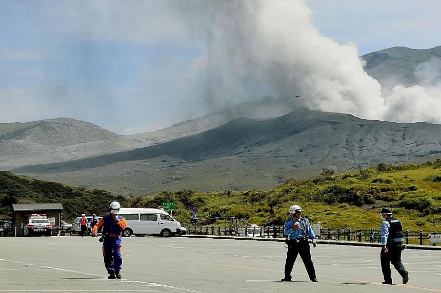 Mount Aso, which has been rumbling since last year, was seen spewing ash and smoke yesterday. Police officers and firefighters evacuated about 30 tourists and shop workers who were near the volcano. There were no immediate reports of injuries or casu