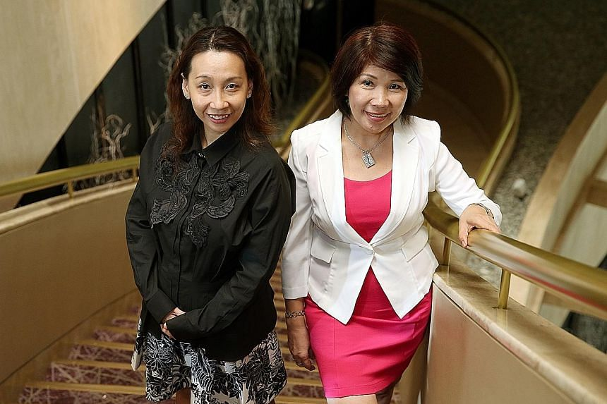 Ms Regina Lee (left), managing director of Amplitude Incorporated, and Madam Cheah Bee Chew, director of Bee Choo Origin, two of this year's Entrepreneur of the Year award winners. Ms Lee received the New Entrepreneur award while Madam Cheah is a sec