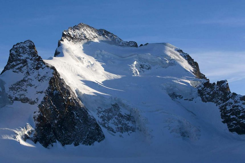 An archive picture shows the Dome and the Barre des Ecrins mountains in the French Alps, near Pelvoux.
