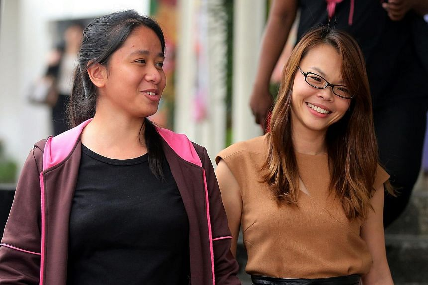 Lawyer R. Thrumurgan and his wife, Ms Priscilla Yip (right), executed a $5,000 bond to ensure good behaviour from Carmen Chng (left), together with Carmen's mother.