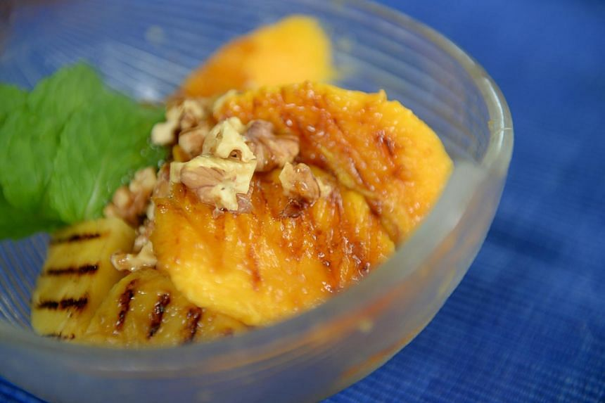 Grilled banana, mango and pineapple, drizzled with a gula melaka-based syrup and topped with nuts.