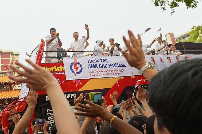 Prime Minister Lee Hsien Loong and his team make their way around Ang Mo Kio GRC on an open-top bus to thank voters for their support on Sept 12, 2015.