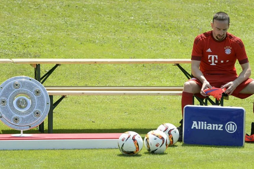 Franck Ribery waiting for the rest of the team during FC Bayern Munich's team photo presentation in Munich, southern Germany.