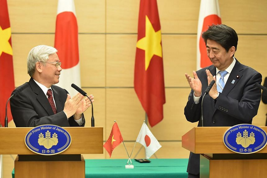 Vietnamese Communist Party General Secretary Nguyen Phu Trong (left) and Japan's Prime Minister Shinzo Abe applaud following their joint press announcement at Mr Abe's official residence in Tokyo on Sept 15, 2015.