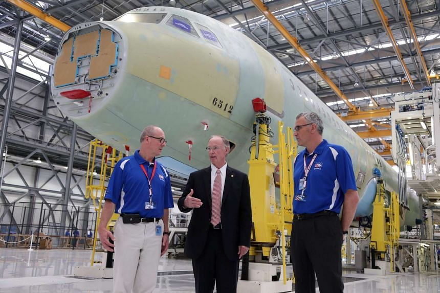 Alabama Governor Robert Bentley (centre) attends the opening of the new Airbus US Manufacturing Facility in Mobile, Alabama.