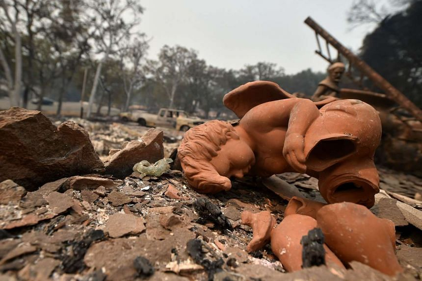 A broken angel statue sits in the rubble of a burned out house in the Valley fire in Middletown, California in the foothills of   Sierra Nevada  mountains on Sunday.