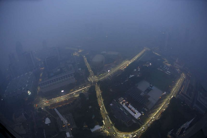 A view of the Singapore F1 Grand Prix night race Marina Bay street circuit shrouded by haze on Sept 14, 2015.