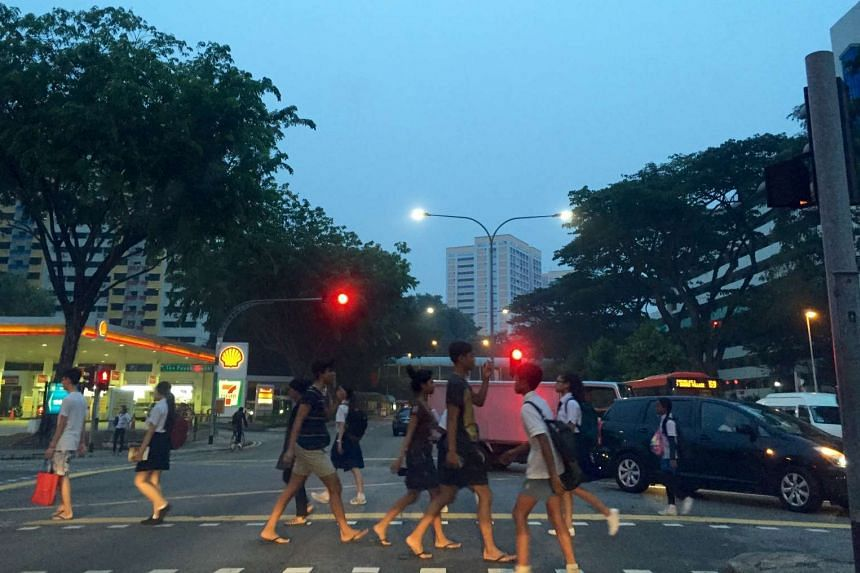Pedestrians crossing a road along Toa Payoh Lor 1 at 7am on Tuesday, Sept 15, 2015.