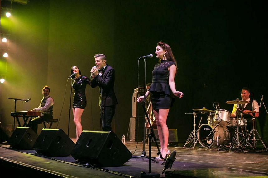 Scott Bradlee (far left, on keyboards) and his outfit entertained with alternative versions of hits.