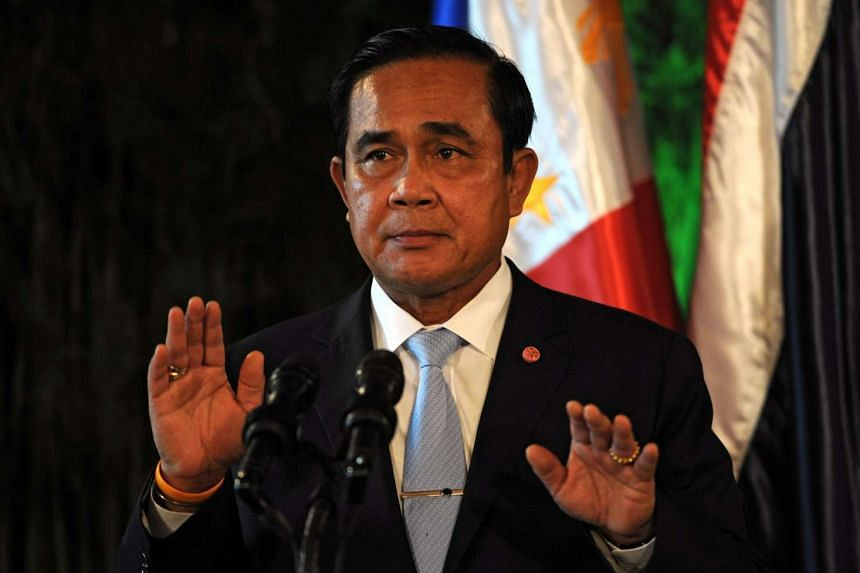 Thailand's Prime Minister Prayut Chan-o-cha gestures as he reads a statement at a press conference during a visit to the Malacanang Palace in Manila on Aug 28, 2015.