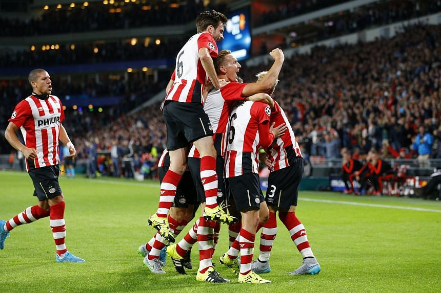 Hector Moreno celebrates with team mates after scoring the first goal for PSV Eindhoven.