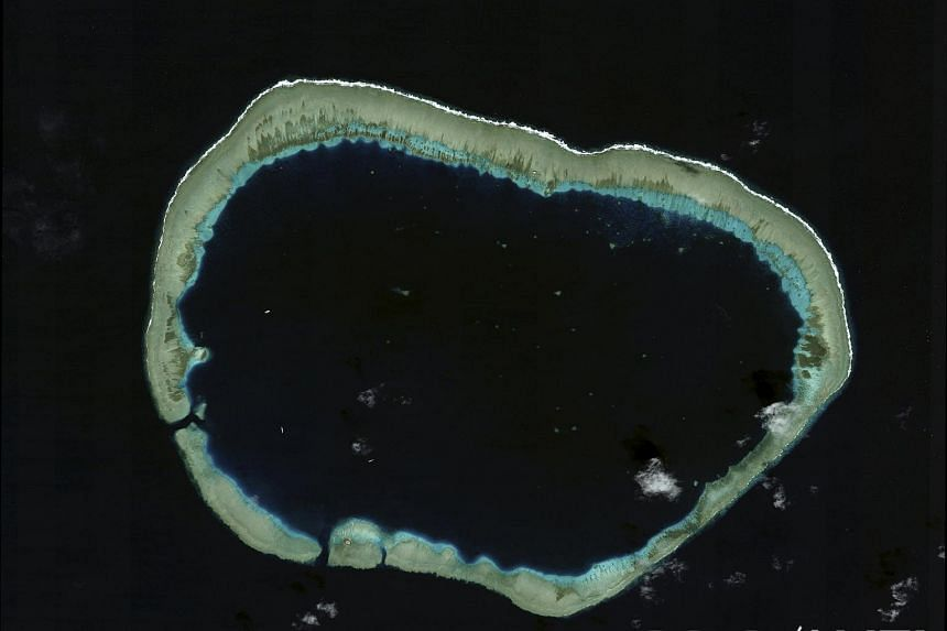Mischief Reef is shown in this handout satellite image dated Jan 24, 2012, and provided by CSIS Asia Maritime Transparency Initiative/Digital Globe on Sept 14, 2015.