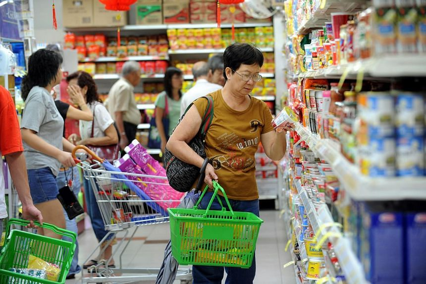 Shoppers at NTUC FairPrice supermarket in Toa Payoh HDB Hub.
