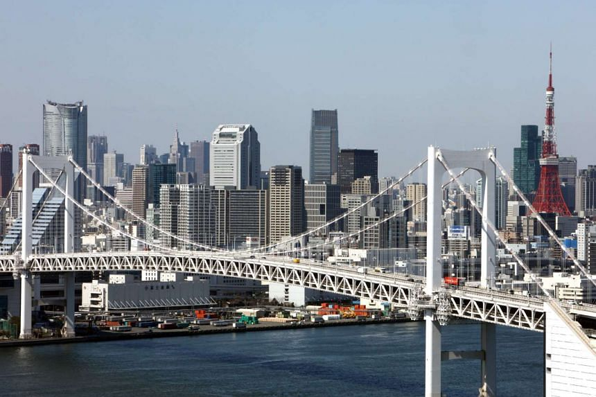 Commercial buildings stand behind the Rainbow Bridge in Tokyo, Japan, on Thursday, Mar 11, 2010.
