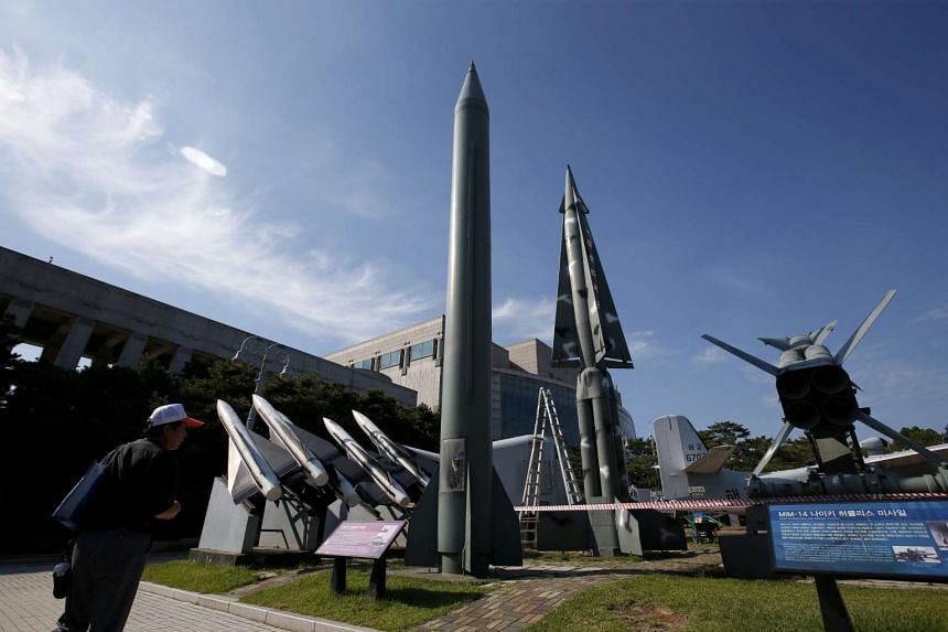 A visitor views a North Korean Scud-B missile (centre) at the Korea War Memorial Museum in Seoul, South Korea, on Sept 15, 2015.