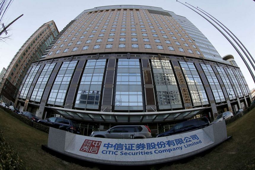 The signboard of CITIC Securities Co. is seen at its head office in Beijing in this March 27, 2013 file photograph.