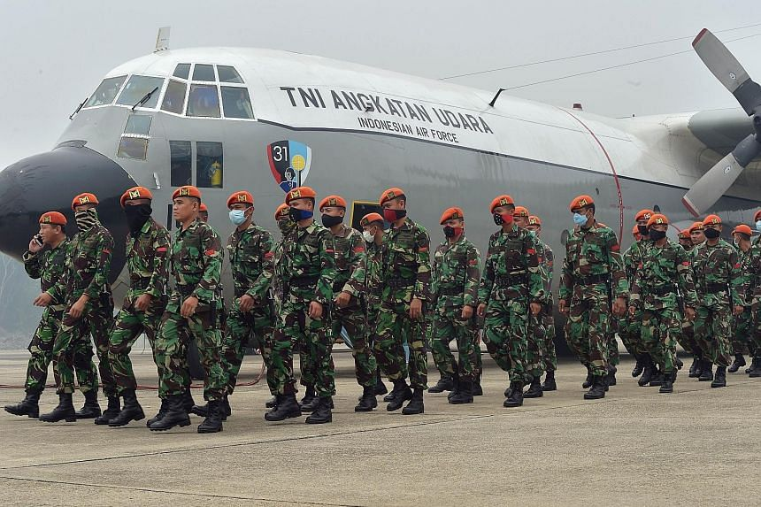 Air force personnel arriving yesterday to help firemen combat fires in Pekanbaru, Riau province.