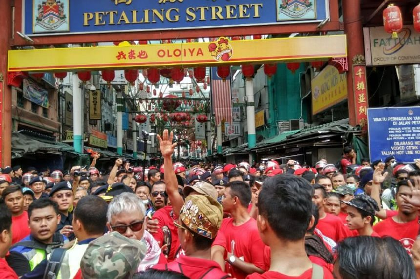 'Red Shirt' protesters at Chinatown in Petaling Street on Wednesday (Sept 16). They were showing support for the Malaysian government. --