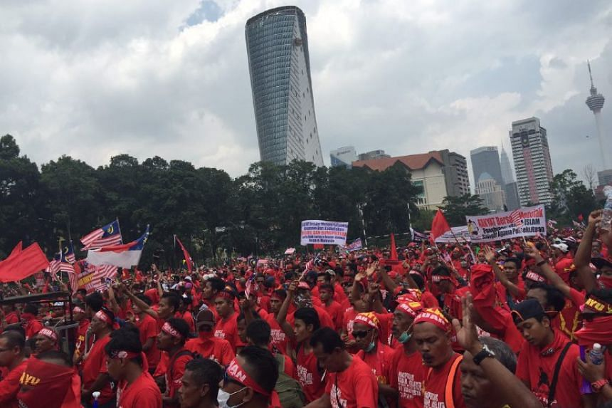 """Protesters listening to speakers on a stage and shouting slogans like """"long live the Malays!!"""" during a rally to show support for the government on Wednesday, September 16"""
