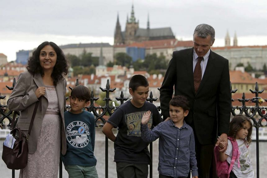 Ashya poses with his family at the medieval Charles bridge in Prague.