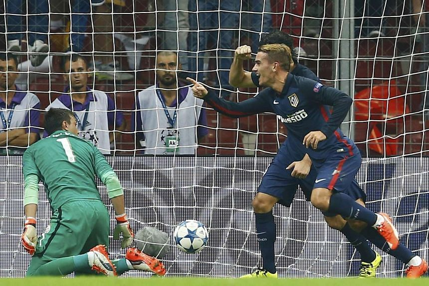 Atletico's Antoine Griezmann (right) celebrates after scoring his second goal past Galatasaray's goalkeeper Fernando Muslera.