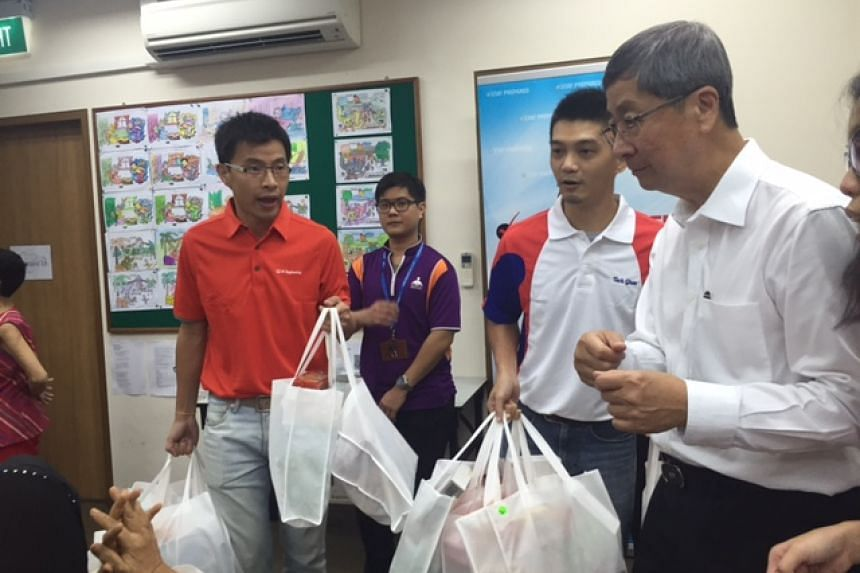 People's Association WeCare PAcks being distributed to seniors at an activity centre in Ang Mo Kio.