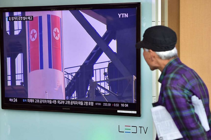 A man watching a news report in Seoul on Sept 15, 2015, on the confirmation from North Korea that the nuclear reactor seen as the country's main source of weapons-grade plutonium had resumed normal operations.