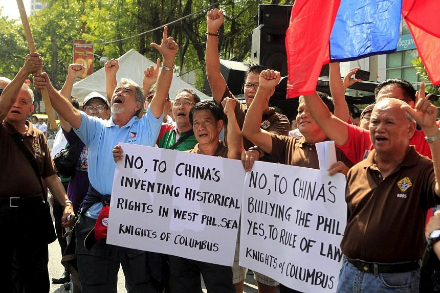 Demonstrators chant slogans during a rally regarding the disputed islands in the South China Sea, in front of the Chinese Consulate in Makati, Metro Manila, on Aug 31, 2015.
