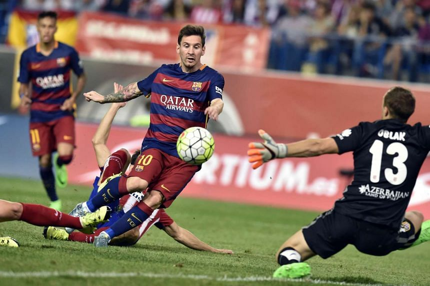 Messi (left) scores against Atletico Madrid on Sept 12, 2015.
