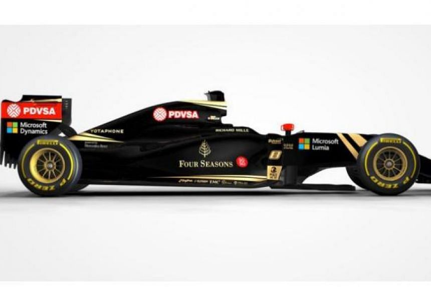 The Four Seasons and SG50 logos are featured on the sidepods of the Lotus F1 team cars.
