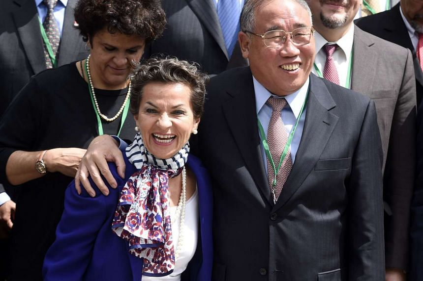 UNFCCC Executive Secretary, Christiana Figueres laughs with China Special representative for climate change Zhenhua Xie  in Paris in July.