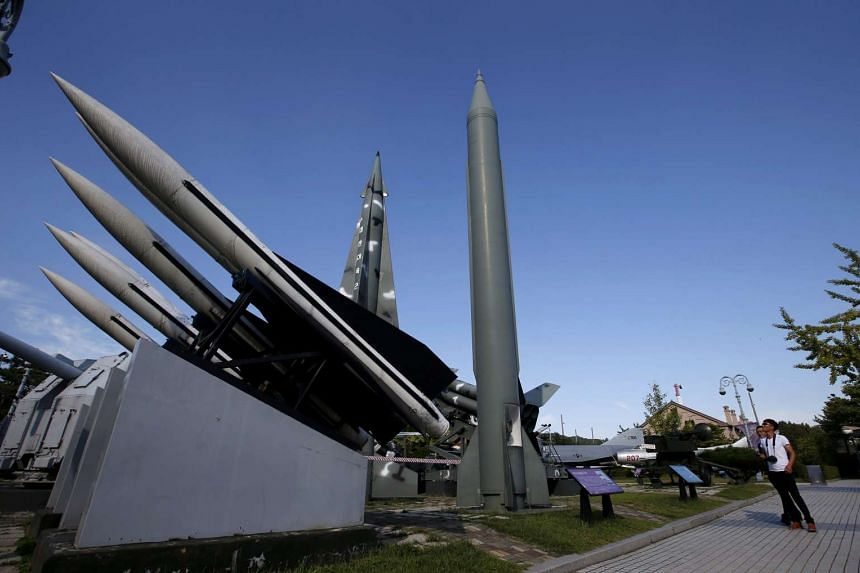 Visitor views a North Korean Scud-B missile (centre) at the Korea War Memorial Museum in Seoul on Tuesday.