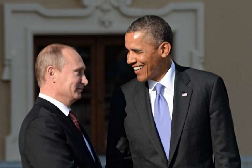 US President Barack Obama is greeted by Russian President Vladimir Putin as he arrives at the official welcome ceremony of the G20 Leaders' Summit in St. Petersburg, Russia on Sept 5, 2013.