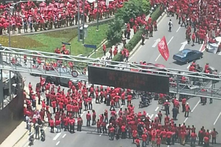 Participants of 'Red Shirt' rally marching towards Padang Merbok in down town Kuala Lumpur on Wednesday (Sept 16).