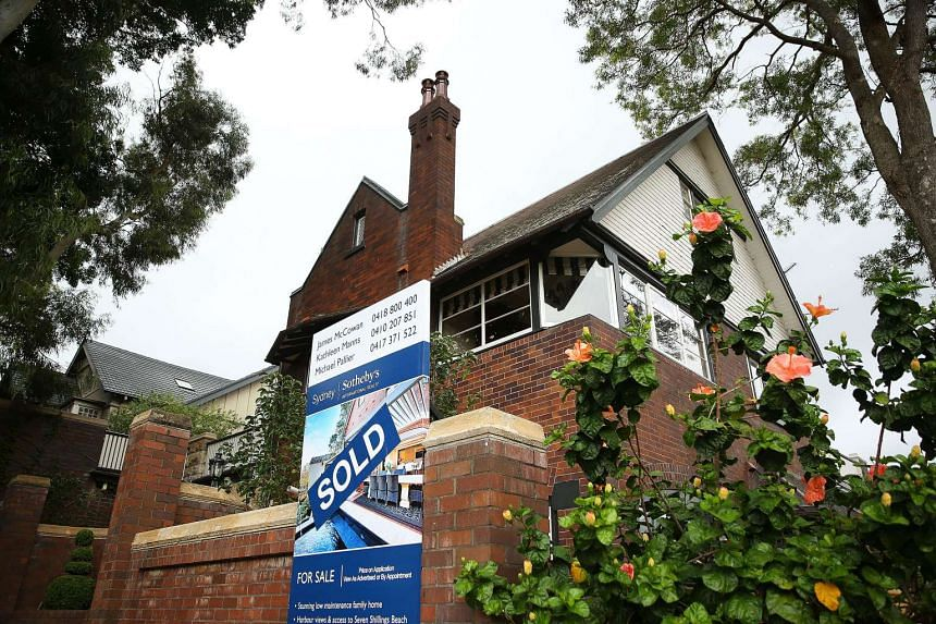 A file picture of a residential property listed by Sotheby's International Realty stands outside a house in the suburb of Point Piper in Sydney, Australia. Foreigners who illegally buy homes in Australia will face higher fines and be forced to sell t