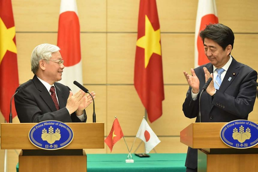 General-secretary of the Vietnamese Communist Party Nguyen Phu Trong (left) with Japanese Prime Minister Shinzo Abe during their joint press conference in Tokyo yesterday. Both leaders expressed concern about the situation in the South China Sea, a v