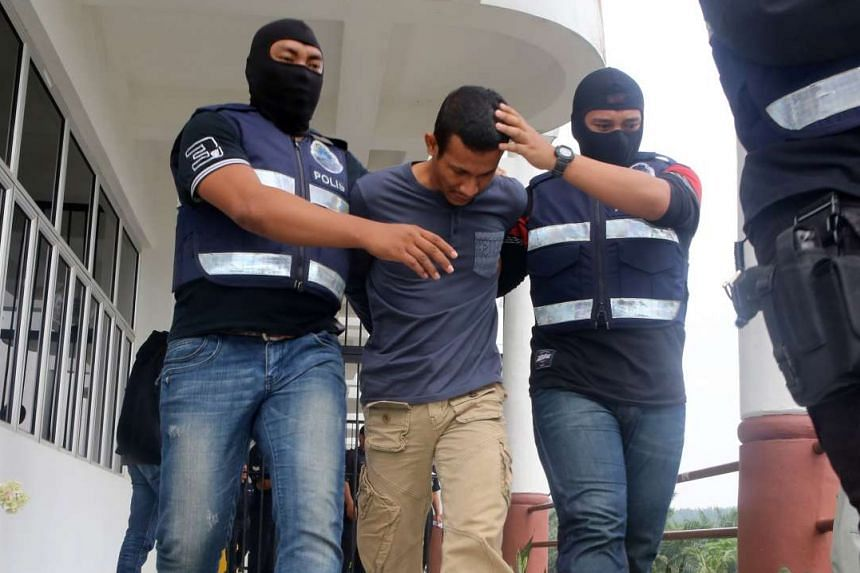 Muhammad Adibzakir Zahri (above) was charged in a magistrate's court in Johor with encouraging membership in ISIS. Fellow commando Mohd Zuraidi Shafiq Zulkeflee was charged separately.