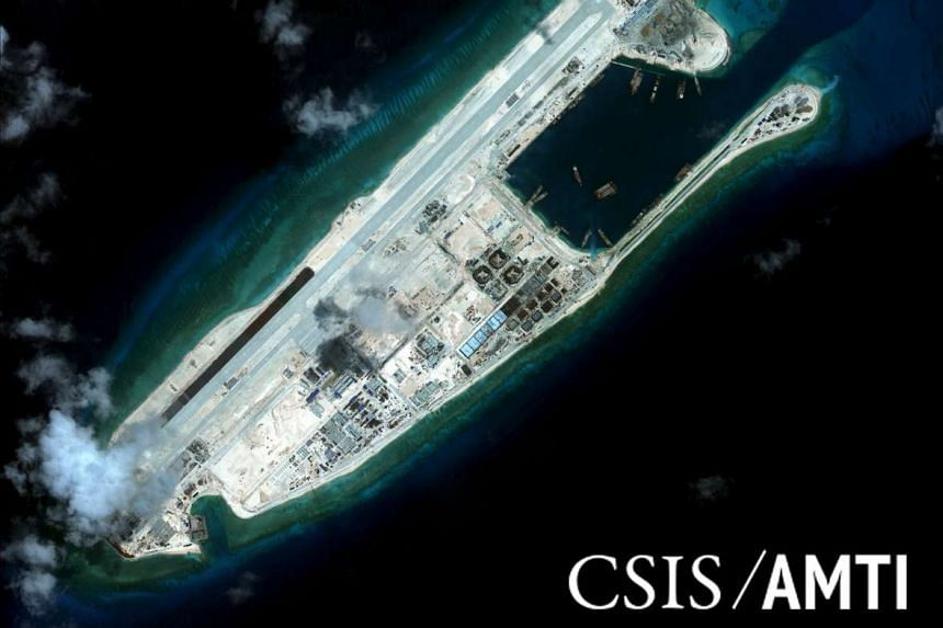 A satellite image of Fiery Cross Reef dated Sept 3. Think-tank CSIS says China is working on another airstrip, on Mischief Reef.