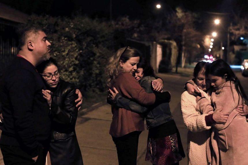 People staying in the streets in Santiago after a strong earthquake struck on Sept 16, 2015.