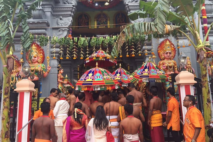 Thousands of devotees gathered early to witness the event which they believe equates to praying and visiting temples for many years.