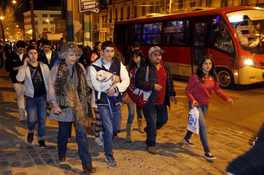 People in Valparaiso city trying to get to higher ground for safety after a mass evacuation of the entire coastline on Sept 16, 2015.